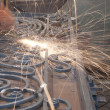 Stock Photo: Worker welding metal. Production and construction