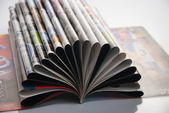 Open magazine with curled pages. Close-up — Stock Photo