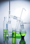 Laboratory glassware over white — Stock Photo
