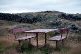Iceland - The Northeast - table and chairs in the lava field — Stock Photo