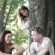 Flirting couple and jealous girl - Stock Photo
