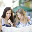 Lost tourists with map - Stock Photo