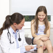 Female doctor checking child patient - Stock Photo