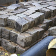 Cobblestones and pipes at a constuction site - Stockfoto