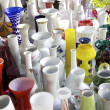 Colorful pots, vases, and ceramics in shop - Stock Photo