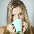 Girl drinking coffee - Stock Photo