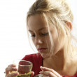 Young woman taking pills - Stock Photo
