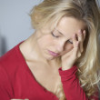 Young woman not feeling well - Stock Photo