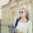 Tourist holding a map - 