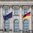 German and EU flags in Berlin, Germany, by the Bundestag, or German Parliament. - Stock Photo