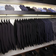Suits and shirts for sale in lusury shop. - Stock Photo