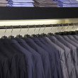 Suits and shirts for sale - Stock Photo