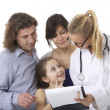 Family at the doctor - Stock Photo