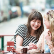 Two friends at the cafe - Stock Photo