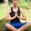 Woman doing yoga - Stockfoto