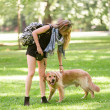 Young woman with her dog in the park — Stok fotoğraf #51427063
