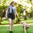 Young woman with her dog in the park — Stok fotoğraf #51427069