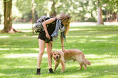 Young woman with her dog in the park — Stock Photo