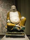 Fat buddha sculpture in museum — Stock Photo