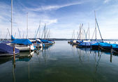 Luxury boats and yachts docked at pier — Stock Photo