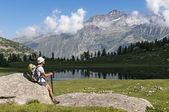 Resting and admiring panorama during trekking in the Alps — Stock Photo