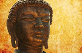 Buddha head on the grunge background — Stock Photo