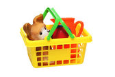 Plastic children's toys in a basket — Stock Photo