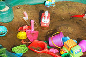 Children's toys in the sandbox   — Stock Photo