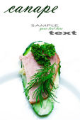 Cucumber canape with place for your text. — Stock Photo