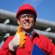 Stock Photo: Smiling Industrial Worker Giving Thumb Up