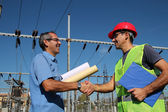 Engineer and Worker at Electrical Substation — Stock Photo