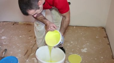 Painter Pouring Yellow Paint - Montage — Stock Video