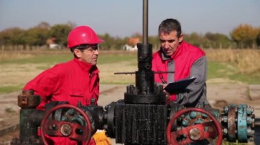 Oil Workers at Well Pump Jack Site — Stock Video