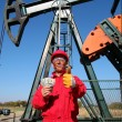 Happy Oil Worker With Money and Pump Jack - Stock Photo