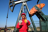 Happy Oil Worker With Money and Pump Jack — Stok fotoğraf