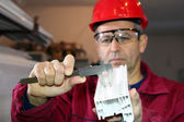 Worker Using a Vernier Caliper — Stock Photo