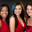 Group of women wearing red dresses — ストック写真