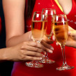 Women holding champagne glasses — ストック写真
