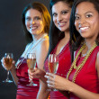 Women holding champagne glasses — Stock Photo #29966941