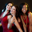 Group of women wearing red dresses — Lizenzfreies Foto