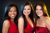 Group of women wearing red dresses — Stock Photo
