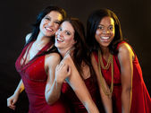 Group of women wearing red dresses — Stockfoto