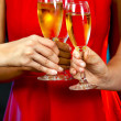 Women holding champagne glasses — Stock Photo #31113881