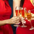 Women holding champagne glasses — Stock Photo #31113911