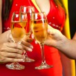 Stock Photo: Women holding champagne glasses