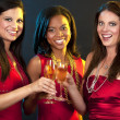 Women holding champagne glasses — Stock Photo