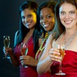 Women holding champagne glasses — Stock Photo #31114501