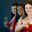 Women holding champagne glasses — Stock Photo #35515599