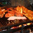 Barbecue with delicious grilled meat - Stock Photo