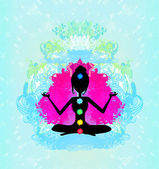 Yoga lotus pose. Padmasana with colored chakra points. — Stock Photo